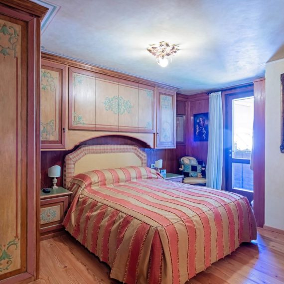 fotografo i interni camera da letto Madonna di Campiglio
